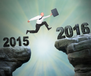 Businessman jumps to The New Year 2016.